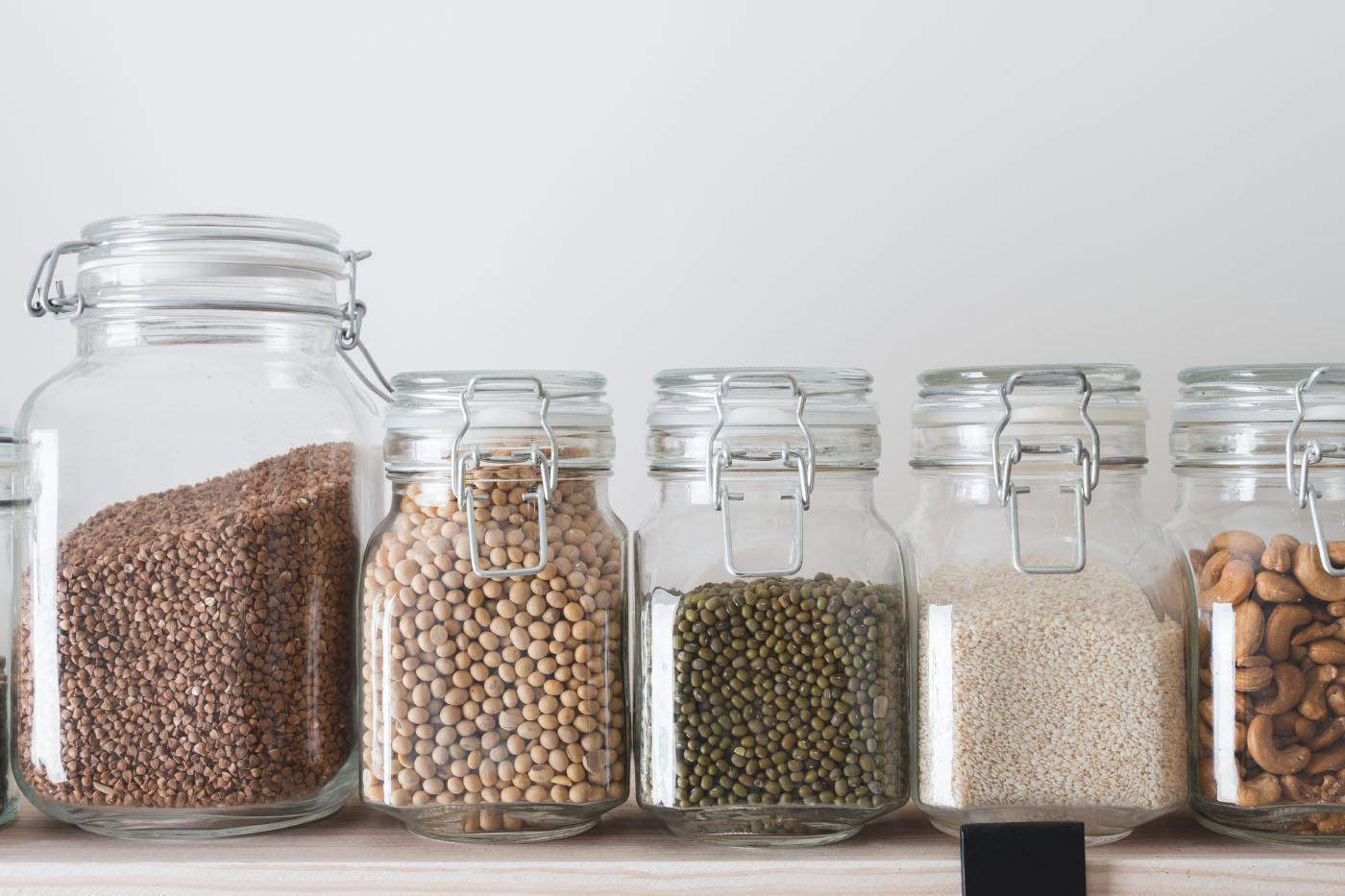 Dried goods in jars on kitchen shelf