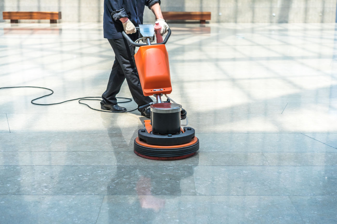 Man using floor scrubber-dryer