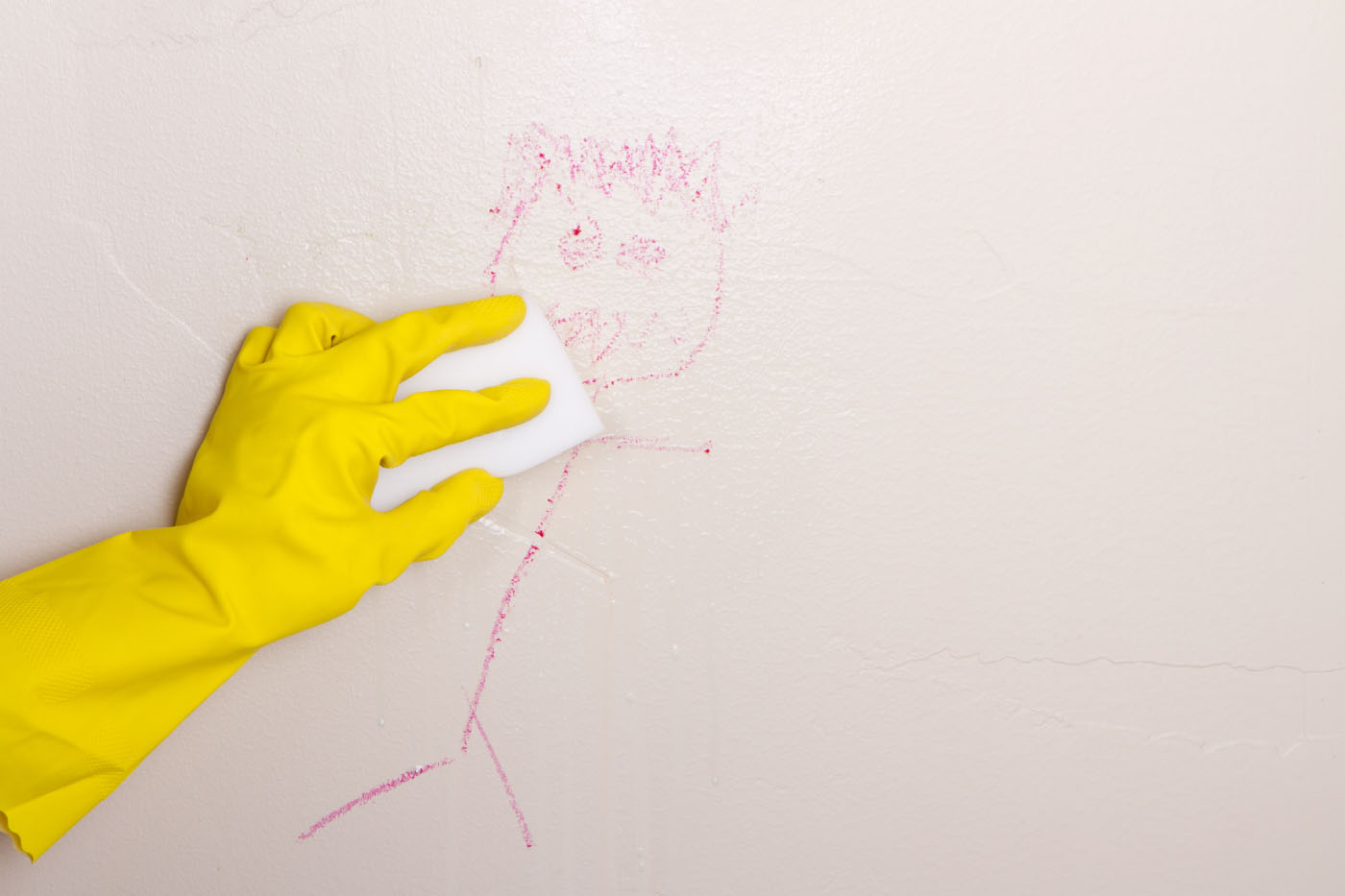 Crayon doodle on pink wall