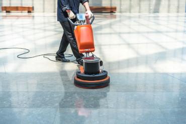 Man using floor scrubber-dryer