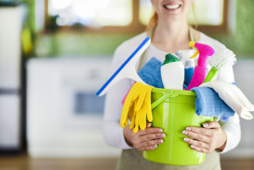 Bucket containing cleaning supplies